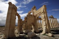 A picture taken in March 2014 shows the iconic arched gate in the ancient Syrian city of Palmyra. The Islamic State destroyed it in 2015.CreditJoseph Eid/Agence France-Presse — Getty Images