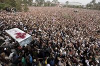 People surrounded the ambulance carrying the body of Malik Mumtaz Hussain Qadri in Rawalpindi, Pakistan. Credit Faisal Mahmood/Reuters
