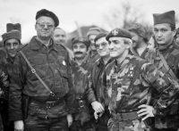 "Serbian ultra-nationalist leader Vojislav Šešelj (left), with paramilitary leader Dragan Vasiljković (""Captain Dragan"") and other Serbian fighters, Croatia, circa 1991. Tanjug / EPA / picturedesk.com"