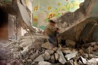 An elementary school in Aleppo, Syria, damaged in fighting. Five years of civil war has put Syrians' lives on hold. Credit Jerome Sessini/Magnum Photos