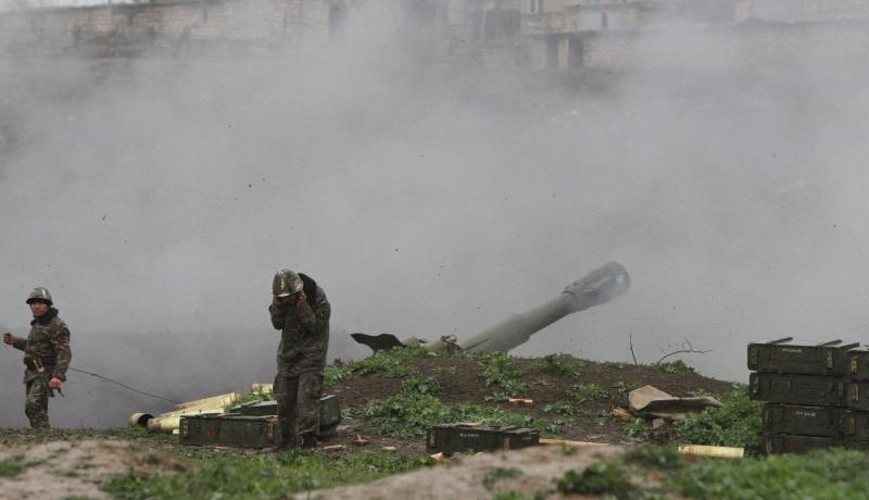 Armenian soldiers fire an artillery shell towards Azerbaijani forces from their positions in the town of Martakert on 3 April 2016. Photo by Getty Images.