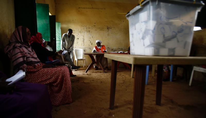Sudanese election staff sit at a polling station in North Darfur's state capital El Fasher on 13 April 2016. Photo by Getty Images.