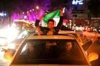 Iranians celebrate on a street in northern Tehran, on April 2, 2015, after Iran's nuclear agreement with world powers in Lausanne, Switzerland. (Ebrahim Noroozi/Associated Press)