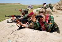 Iraqi Kurdish female fighters near the front line of the fight against Islamic State militants in Nawaran, Iraq, on April 20. (Ahmed Jadallah/Reuters)