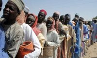 People wait to be served food at Dikwa camp, in Borno, north-eastern Nigeria. More than 50,000 people in the state are critically food insecure. Photograph: Stringer/AFP/Getty Images
