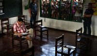 Rodrigo Duterte prepares to vote inside a polling precinct on 9 May 2016 in Davao. Photo by Getty Images.