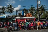 People waited in line in front of a state-run grocery store in Puerto Cabello, Venezuela, in January. Meridith Kohut for The New York Times
