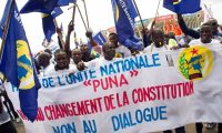 National Unity party demonstrators in the Democratic Republic of the Congo call for elections on 24 April 2016. The banner reads: 'No to constitutional change, No to talks'. Photograph: Junior Kannah/AFP/Getty Images