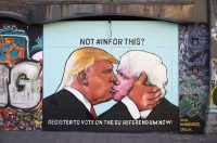 A mural showing Donald Trump sharing a kiss with former London Mayor and leading Brexit supporter Boris Johnson, Bristol, England, May 24, 2016. Matt Cardy/Getty Images.
