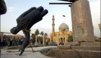 US troops topple statue of Saddam Hussein in central Baghdad on 9 April 2003. Photo via Getty Images.