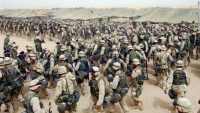 U.S. Marines in northern Kuwait gear up after receiving orders to cross the Iraqi border on March 20, 2003. It has been more than 10 years since the American-led invasion of Iraq that toppled the regime of Saddam Hussein. Look back at 100 moments from the war and the legacy it left behind