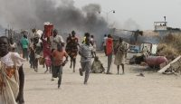 South Sudanese civilians flee fighting in an United Nations base in the northeastern town of Malakal on 18 February 2016. Photo by Getty Images.
