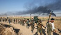 Iraqi pro-government forces advance towards the city of Fallujah on 23 May 2016. Photo by Getty Images.