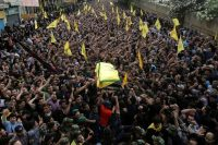 Hezbollah members carry the coffin of top Hezbollah commander Mustafa Badreddine, who was killed in an attack in Syria, during his funeral in Beirut's southern suburbs on May 13. (Aziz Taher/Reuters)