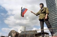 Waving a Russian flag in Moscow for victims of the failed coup in August 1991 — a Russian version of a velvet revolution — that has been memorialized as the end of the Soviet Union. Dimitri Korotayev/Agence France-Presse