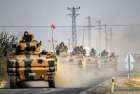 A convoy of Turkish Army tanks heading toward the Syrian-Turkish border town of Jarabulus on Thursday. Bulent Kilic/Agence France-Presse — Getty Images