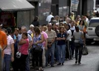 Shoppers in Venezuela must wait in line for hours outside stores to find basic consumer goods like sugar and detergent. Fernando Llano AP