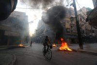 Burning tires in Aleppo, Syria, this month to create smoke cover from airstrikes. Abdalrhman Ismail/Reuters
