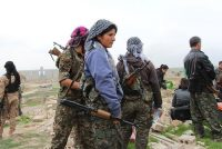 Kurdish fighters in Tal Hamis, Syria, after it was freed from Islamic State control last year. Massoud Mohammed/Barcroft Media, via Getty Images