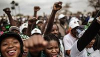 Supporters of the Zambian ruling party Patriotic Front at the closing rally of President Edward Lungu's campaign on August 10, 2016 in Lusaka. Photo by GIANLUIGI GUERCIA/AFP/Getty Images.