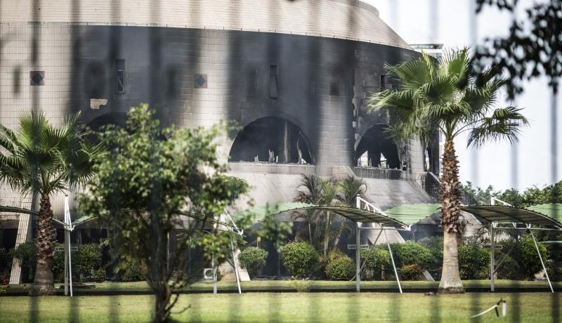 The charred rear of the National Assembly after it was torched by protesters in Libreville. Photo by Getty Images.