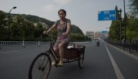 A woman drives her tricycle in Hangzhou before the G20 summit. Photo by Getty Images.