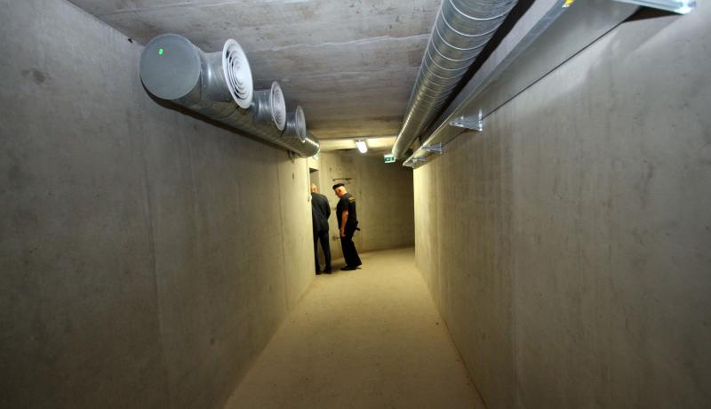 Military personnel walk in the underground communication tunnel of the training centre for urban warfare in Pabrade, Lithuania. Photo by Getty Images.