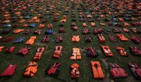 Lifejackets on display Monday in London represented refugees who died trying to reach Europe. Credit Daniel Leal-Olivas/Agence France-Presse — Getty Images