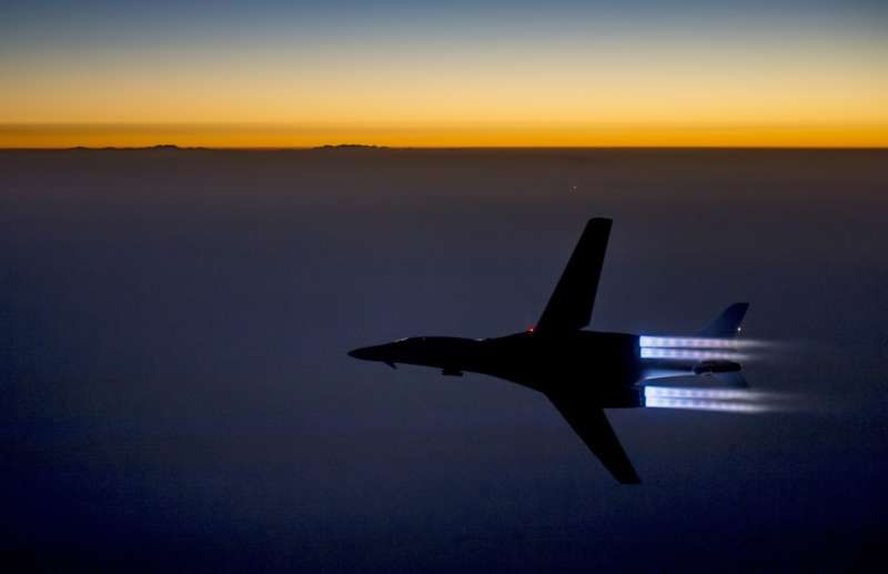A U.S. fighter jet flies over northern Iraq after conducting airstrikes in Syria against Islamic State group targets in Syria. (Senior Airman Matthew Bruch/Associated Press)