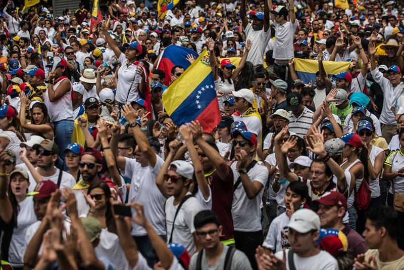 Venezuelans marching this month in Caracas in protest against the government. Meridith Kohut for The New York Times