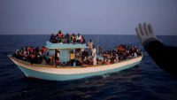 A boat with 158 migrants is spotted by the Italian coast guard in Lampedusa, Italy, on 8 July 2011. MAGNUM/Patrick Zachmann