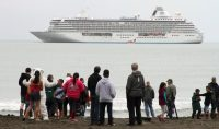 "The luxury ship Crystal Serenity, anchored off Nome, Alaska, in August, on its inaugural Northwest Passage voyage. ""We had to look for ice rather that try to avoid it,"" a passenger said. Mark Thiessen/Associated Press"