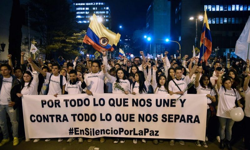 Peace marchers in Bogotá, with a banner reading 'For all that unites us and against all that separates us'. Photograph: Guillermo Legaria/AFP/Getty Images