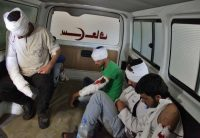 Wounded opposition fighters sit in the back of an ambulance in a government-held neighborhood of Aleppo in Syria on Thursday. (George Ourfalian/Agence France-Presse/Getty Images)