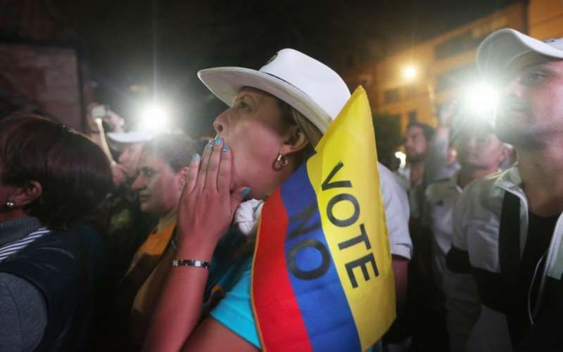 """No"" supporters gather at a rally following their victory in the referendum on a peace accord to end the guerrilla war between the FARC and the state on Oct. 2 in Bogota, Colombia. (Mario Tama/Getty Images)"