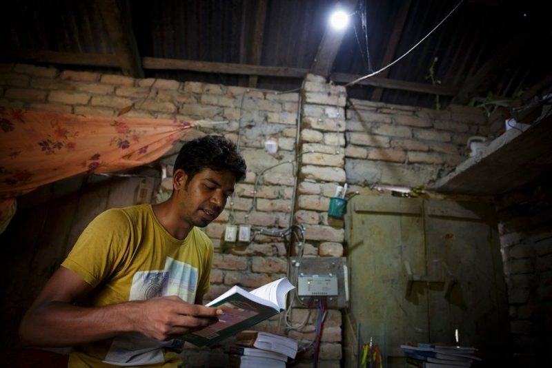 A solar panel generates electricity for this home in Bangladesh. Credit Thomas Trutschel/Photothek, via Getty Images