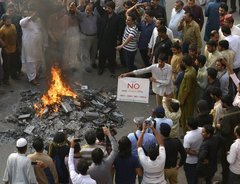 Pakistani shopkeepers and traders burn Indian products including TV transmission systems during a demonstration in Lahore on Oct. 8. Arif Ali/Agence France-Presse — Getty Images