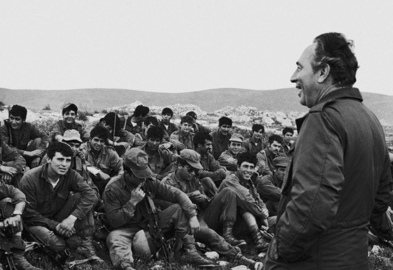 Israeli Defence Minister Shimon Peres (right) addresses Israeli paratroops after the completion of Operation Entebbe, July 1976. Keystone/Hulton Archive, via Getty Images