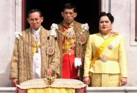 (L-R) Thai King Bhumibol Adulyadej, Crown Prince Maha Vajiralongkorn and Queen Sirikit on a balcony of Anantasamakom Throne Hall in Bangkok to mark the King's birthday on December 5, 1999. PORNCHAI KITTIWONGSAKULPORNCHAI KITTIWONGSAKUL/AGENCE FRANCE-PRESSE via Getty Images
