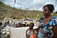 Jaqueline and her children stand among the ruins of their home, which was destroyed in Hurricane Matthew, in Chabet in southwestern Haiti. (Hector Retamal/Agence France-Presse via Getty Images)