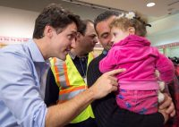 Prime Minister Justin Trudeau greeted Madeleine Jamkossian, right, and her father, Kevork Jamkossian, after the Syrian refugees arrived in Toronto in December. Nathan Denette/The Canadian Press via Associated Press