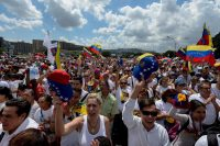 Opponents to President Nicolás Maduro's government march during a demonstration in Caracas on Saturday. Federico Parra/Agence France-Presse — Getty Images
