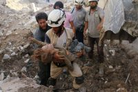 A White Helmet volunteer holding the body of a child pulled from the rubble in Aleppo, Syria, this month. Ameer Alhalbi/Agence France-Presse — Getty Images
