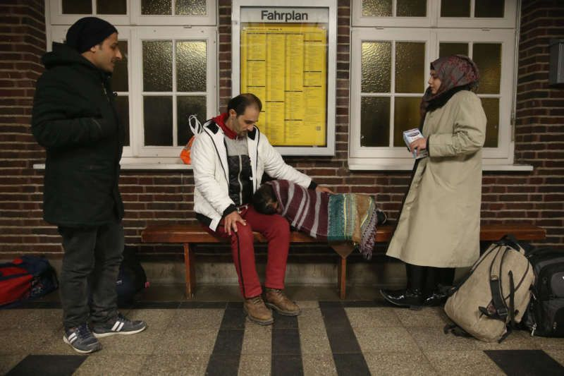 Refugees from Syria hoping to receive asylum in Denmark wait for a train in Germany near the Danish border in January. Sean Gallup/Getty Images