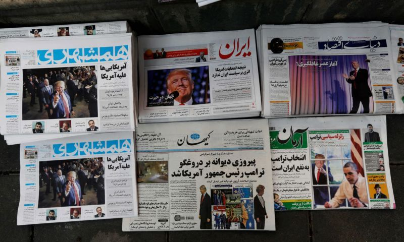 'Despite Donald Trump's anti-Muslim rhetoric, he has some supporters in the Middle East.' Iranian newspapers report his election victory. Photograph: Atta Kenare/AFP/Getty Images