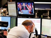 A broker at the Frankfurt stock market on Wednesday as U.S. President-elect Donald J. Trump spoke on TV. Michael Probst/Associated Press