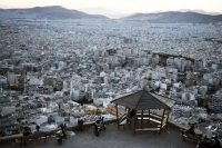 The urban sprawl of Athens. Construction of homes has collapsed across Greece, dropping by 95 percent from 2007 to 2016. Louisa Gouliamaki/Agence France-Presse — Getty Images