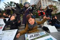 Protesters wearing masks of President Park Geun-hye of Korea, forward, and her confidante Choi Soon-sil, rear, in Seoul last month. Credit Jung Yeon-Je/Agence France-Presse — Getty Images