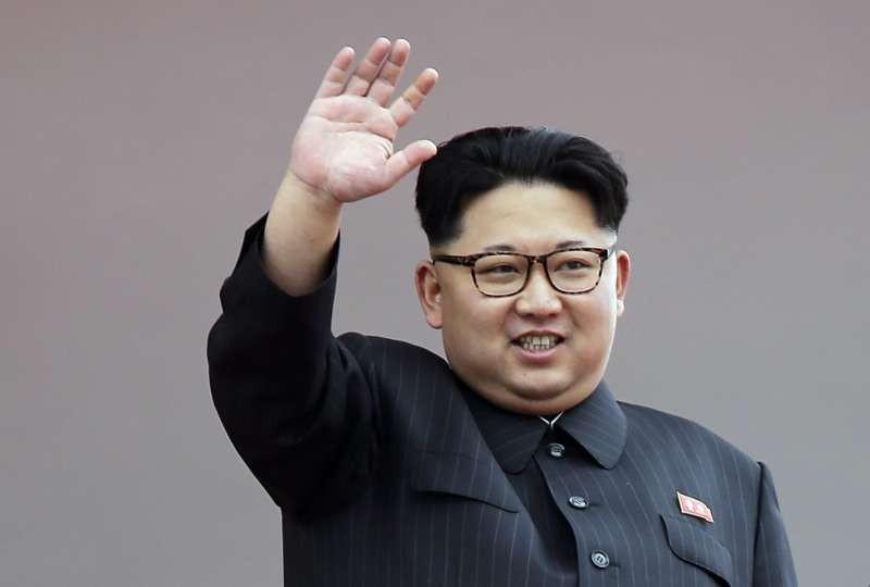 North Korean leader Kim Jong Un waves at parade participants at the Kim Il Sung Square in Pyongyang, North Korea, on May 10. (Wong Maye-E/Associated Press)