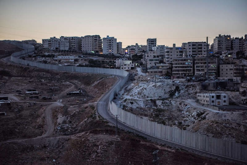 The West Bank Barrier, a projected length of 440 miles, was built by Israel to thwart suicide bombers of the second intifada, which began in 2000. Construction was halted in 2013, and resumed this year. Credit Daniel Berehulak for The New York Times
